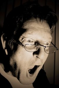 surprised man wearing glasses