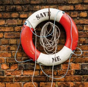 life preserver printed with the words save me