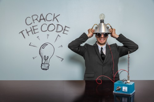 man wearing goofy contraption on head next to the words crack the code