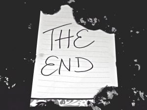 tattered page with 'the end' written on it