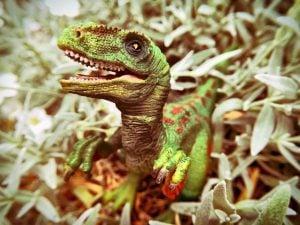 velociraptor model in grass
