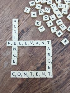 scrabble tiles spelling out 'audience', 'relevant', 'content'