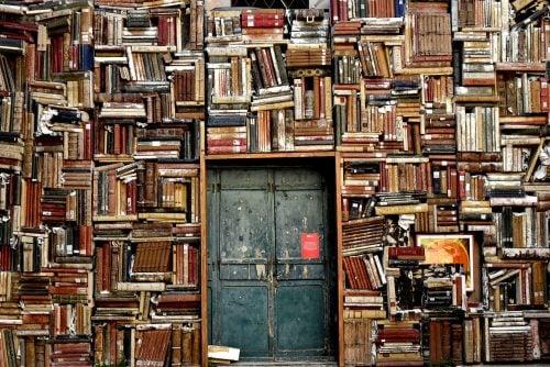 wall of school books surrounding blue double doors