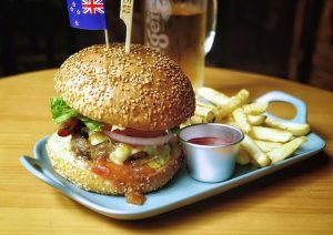 australian cheeseburger, fries, and beer