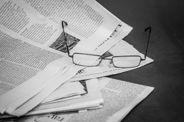 glasses and newspaper op-ed page