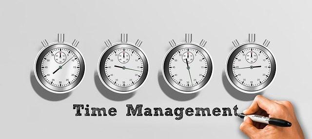 graphic with multiple clocks labeled 'time management'