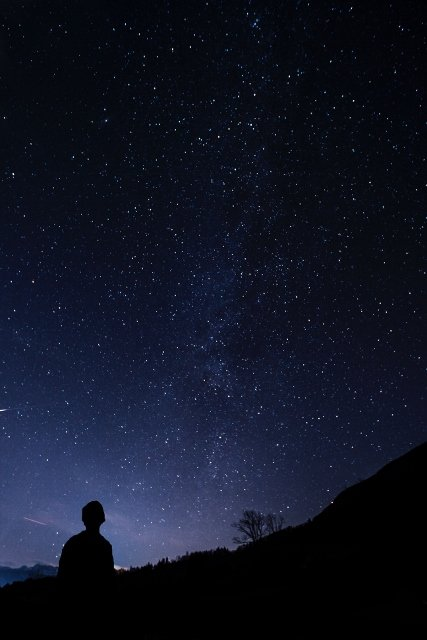 child looking up at night sky and stars