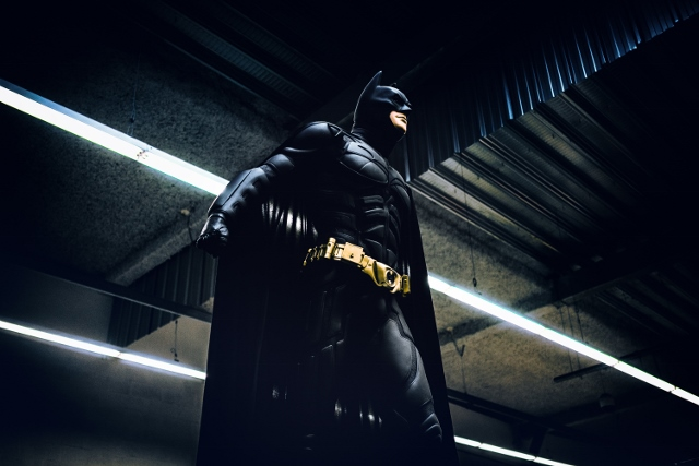 batman standing in industrial building
