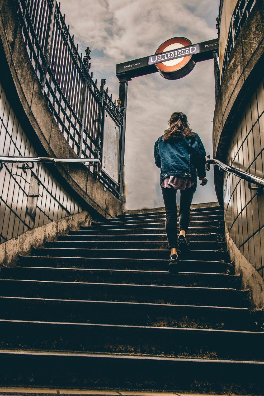 woman walking up concrete steps